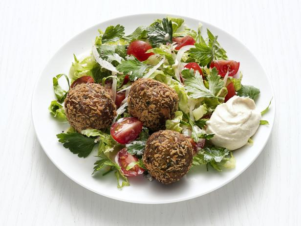 Recipe courtesy of Food Network Kitchen Falafel Salad with Hummus Dressing Recipe