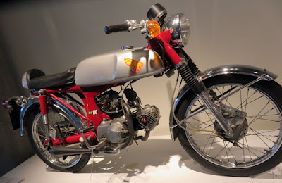 Small motorcycle has combination of two motors.