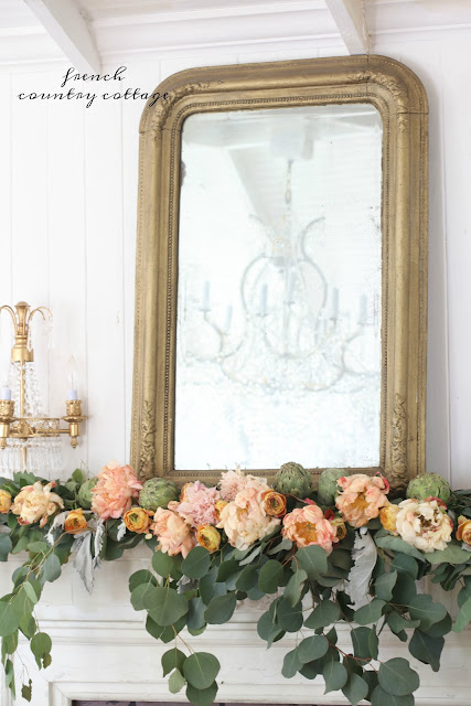 flowers and greens for autumn mantel
