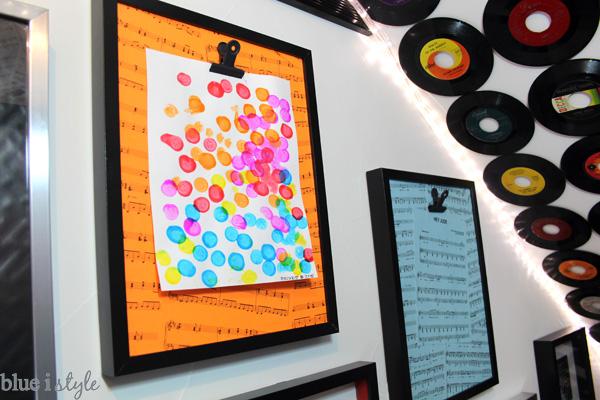 Kids' art display in under stair playroom