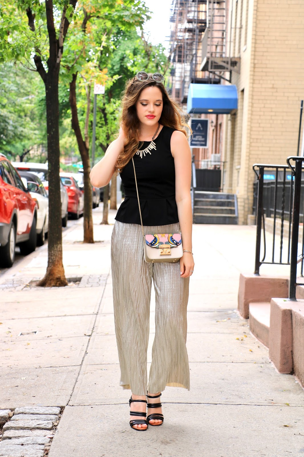 nyc fashion blogger Kathleen Harper wearing gold culottes and a black peplum top