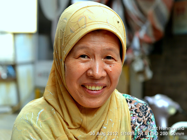 street portrait, headshot, China, Xi'an, Hui Muslims, Hui Muslim woman, headscarf, yellow hijab
