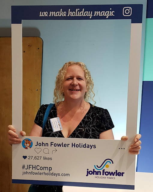 John Fowler Holidays comp entry holding instagram frame around face