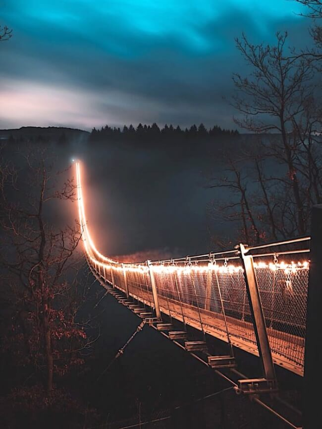 25 Breathtaking Pictures That Made Us Gasp - This backlit bridge in the fog is impressive.