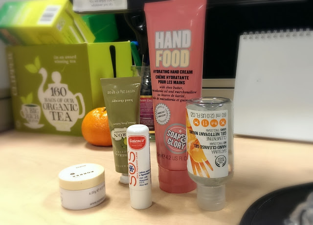 A collection of hand & lip products for the desk