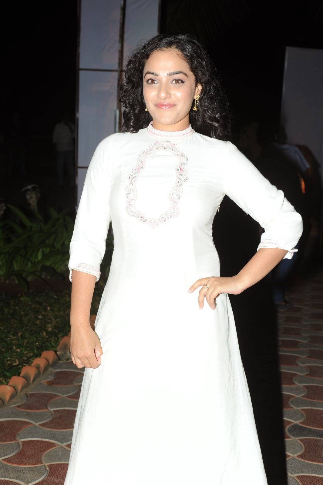 Actress Nithya Menon Stills At Movie Audio Launch In Full White Dress