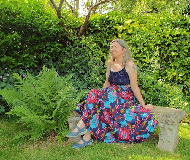 Joe Browns Hiippy style dress from JD Williams website modelled in a green and leafy garden