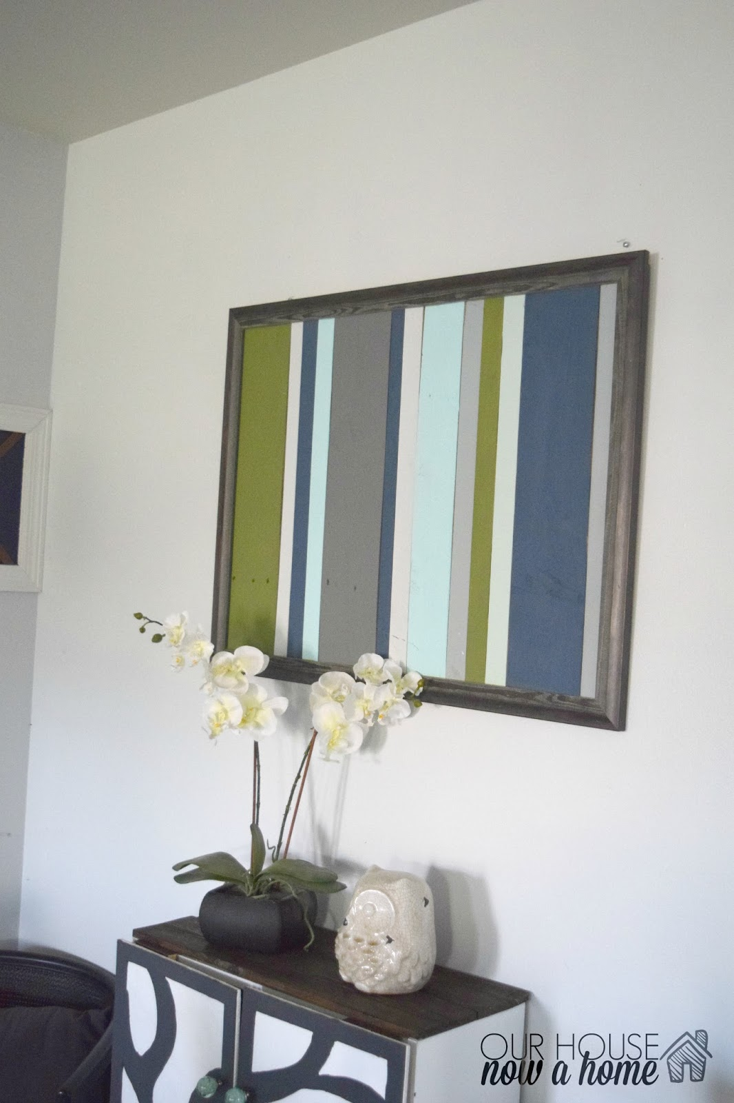Broken wall art gets a new life with this diy wood pallet frame • our house now a home