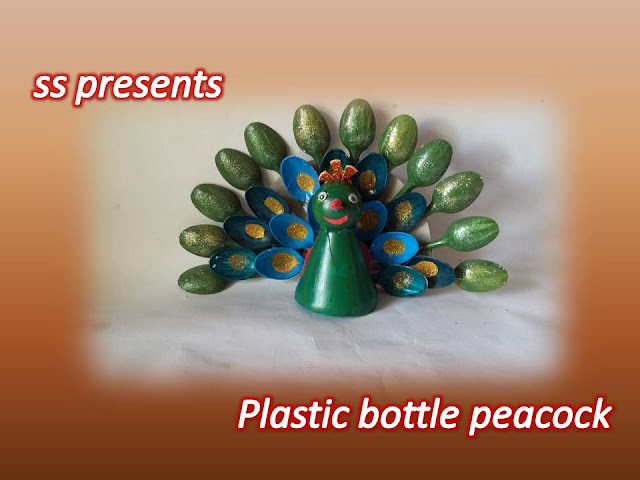 Here is plastic bottle crafts,kids crafts,plastic bottle show piece,plastic bottle room decor ideas,plastic bottle tree making at home,plastic bottle christmas tree,PLASTIC BOTTLE AND PEARLS TREE,how to make peacock using with plastic bottle