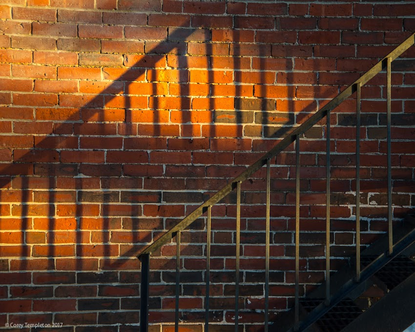 Portland, Maine USA April 2017 photo by Corey Templeton. Some dramatic light and shadows on a staircase off of Washington Avenue this afternoon.