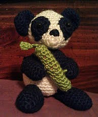 http://www.ravelry.com/patterns/library/panda-with-bamboo-amigurumi