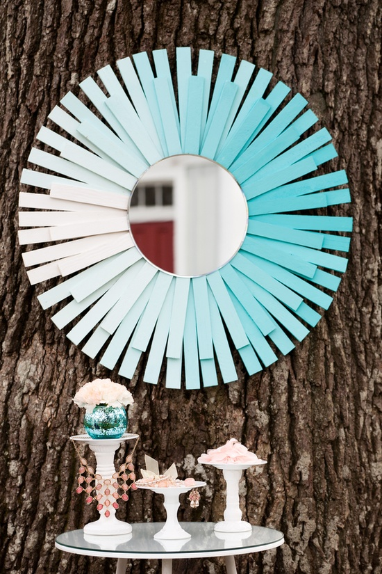 This blue ombre colored mirror made from paint sticks is fun and whimsical.
