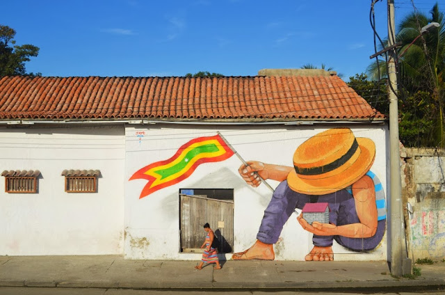 Street Art by Peruvian Artist JADE on the streets of Cartagena in Colombia. 3