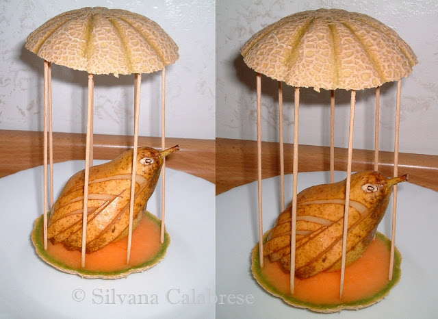 Carvings little bird  in cage with pear Loving San Francisco