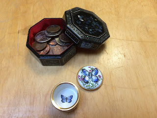 One opened inlaid box displaying coins, one open enamel box displaying painted butterfly on the bottom