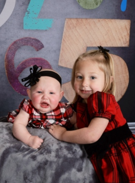 School Picture - Linley was not too happy to have Annabell join her picture.