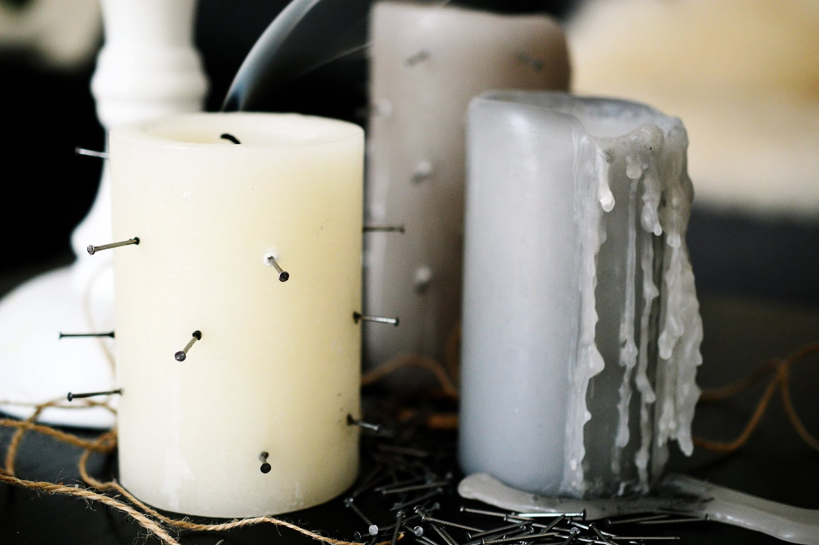 candles tortured by sticking nails in from the side for Halloween