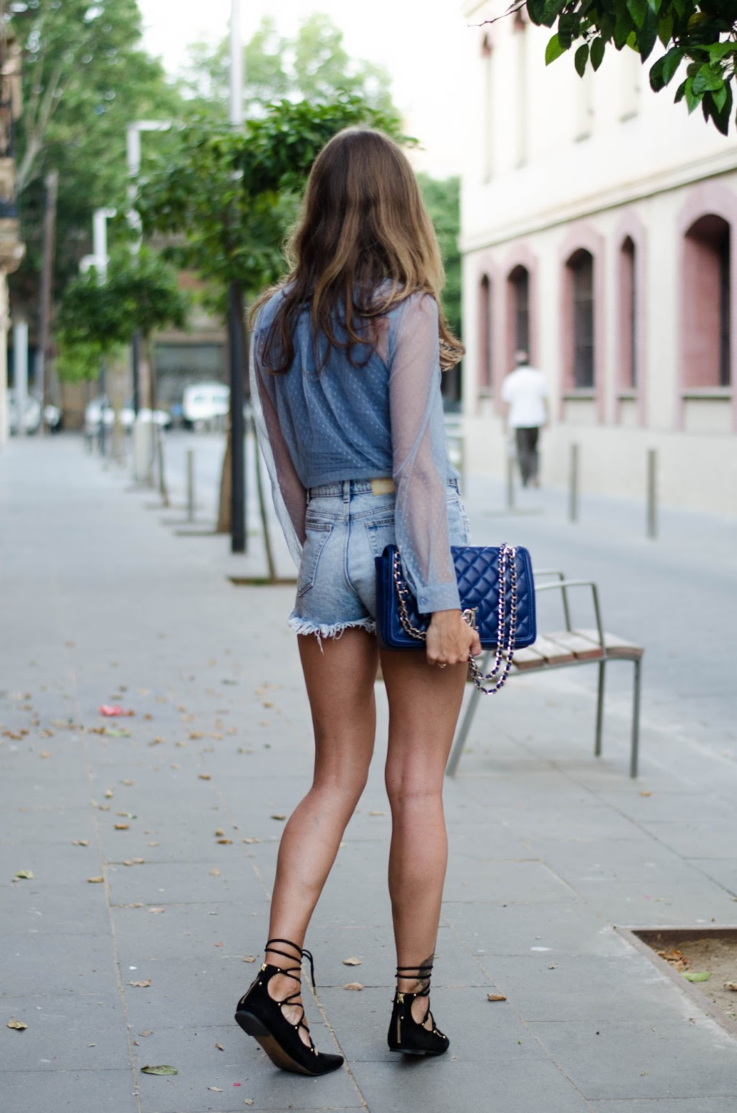 denim shorts lace up shoes sheer blouse