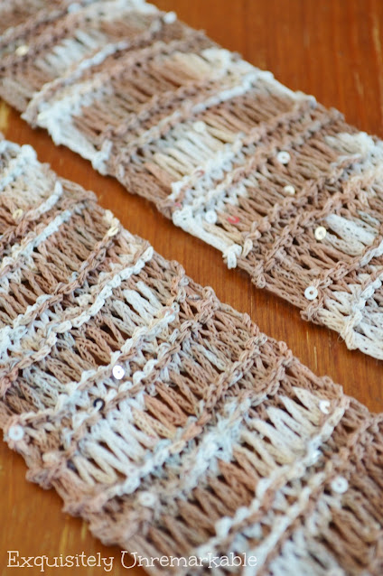 A knitted beige and white scarf