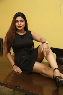 Tollywood Upcoming Actress Pooja Roshan Stills in Black Short Dress at Plus 1 Movie Trailer Launch  0173.JPG