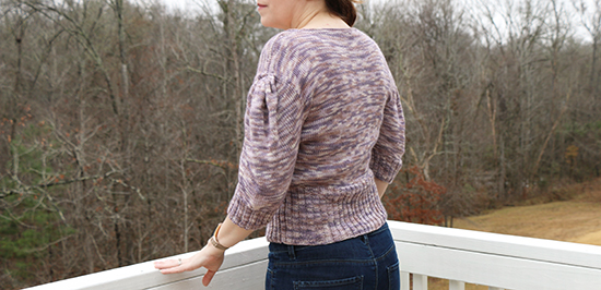Back View of Hand-Knit Diamond Peplum Pullover in Light Purple