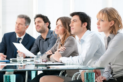 5 business people are listening carefully