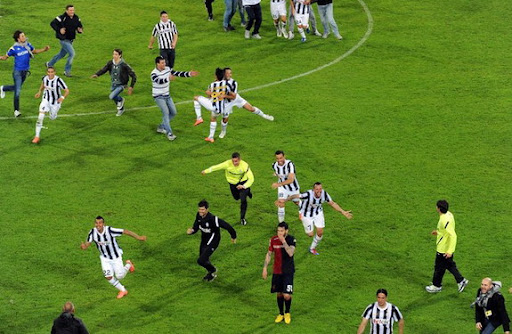 Juventus players celebrate winning the Scudetto at the end of a game against Cagliari