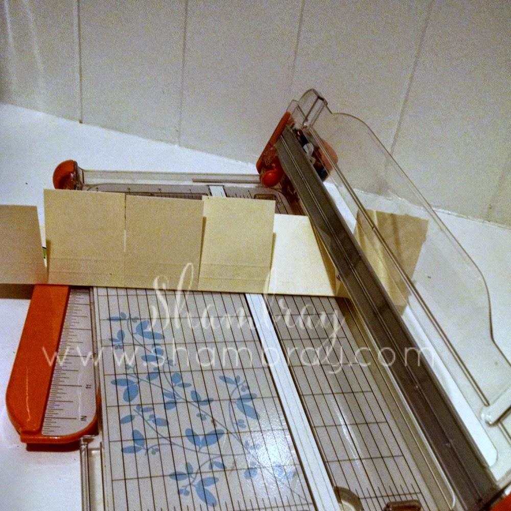 manila folder, paper cutter