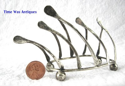https://timewasantiques.net/products/edwardian-wishbone-toast-rack-toast-points-for-pate-ball-feet-england