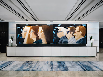 Chani Nicholas doesn't care for the hulking Alex Katz painting, depicting a trio of suited white men, hanging behind the front desk of the Langham hotel in New York. It reminds her of the patriarchy...