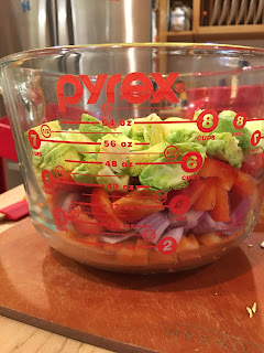 pyrex filled with brussel sprouts and onions