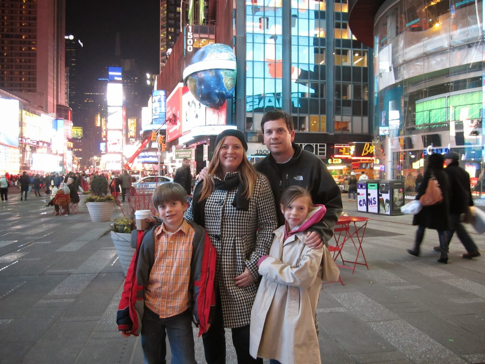 times square, family smiling, new york city