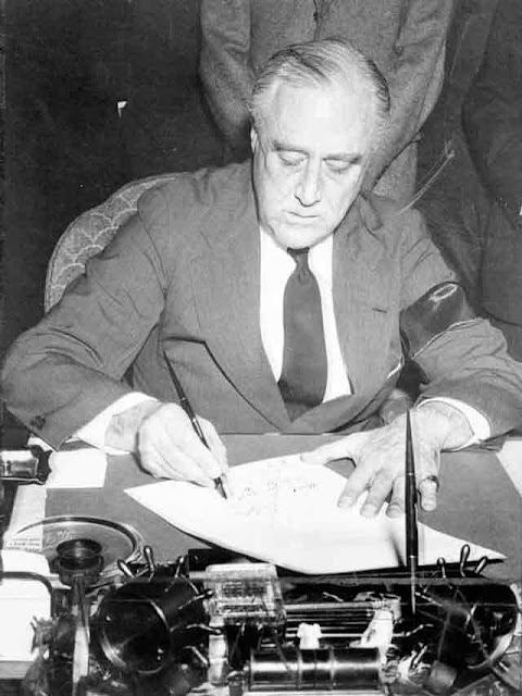FDR signs the declaration of war, 11 December 1941 worldwartwo.filminspector.com