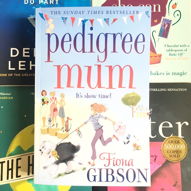 Pedigree Mum by Fiona Gibson book in the centre, laid on top of 4 other books