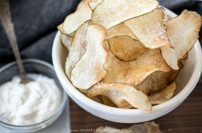 Bowl of homemade chips and bowl of dip