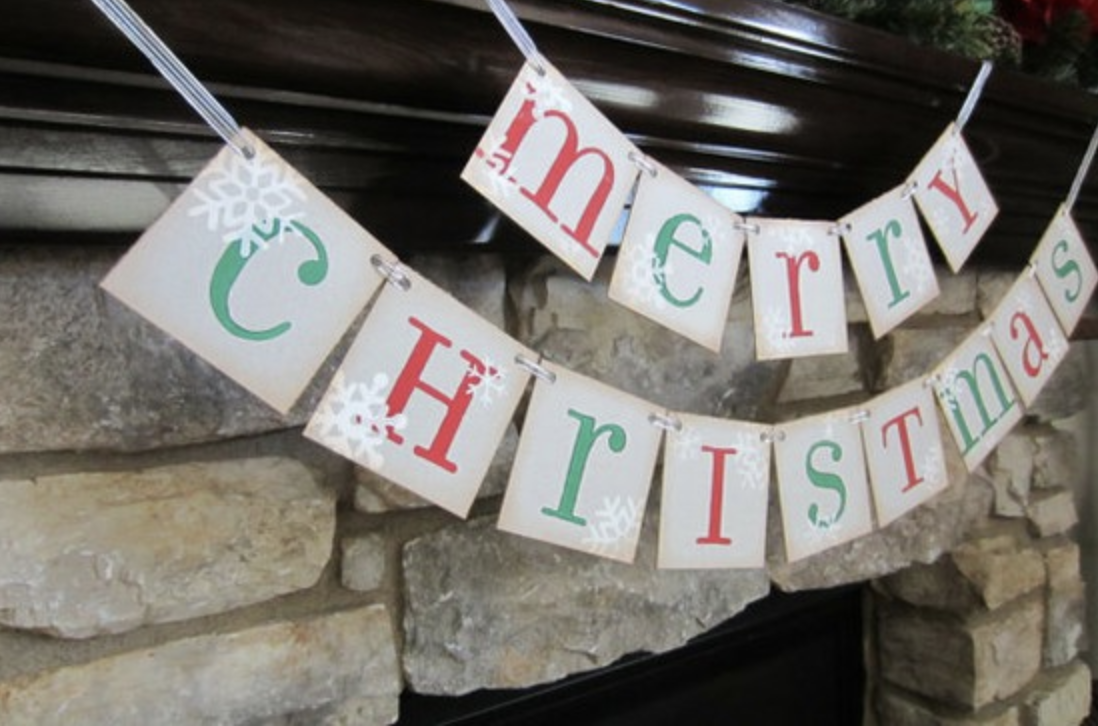 Merry Christmas banner over fire place