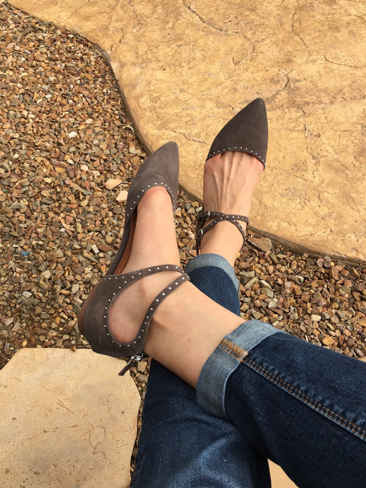 This is a close-up of these pointed toe, tie up gray suede flats.