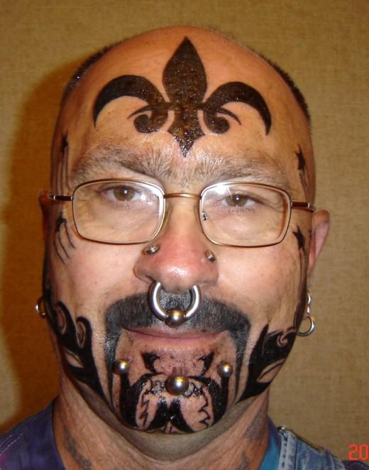 latest face tattoos design for men 520x662