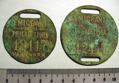 "PA Railroad round metal baggage tags marked ""emigrant"" (19th century?)"