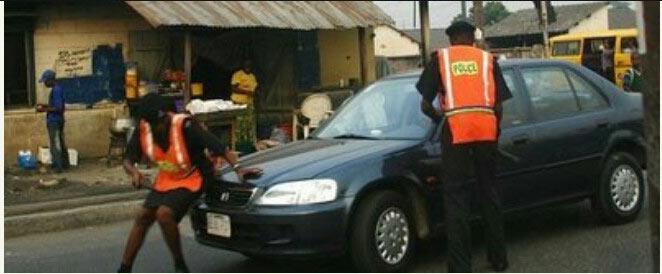 Between a motorist and a Nigerian policewoman