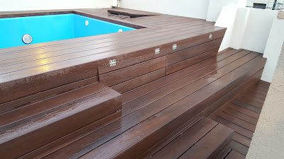 Pool deck with bench and storage