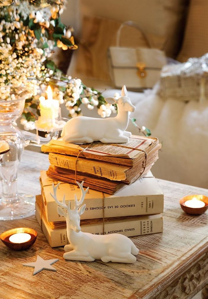French Christmas decor with white reindeer and vintage books on Hello Lovely Studio