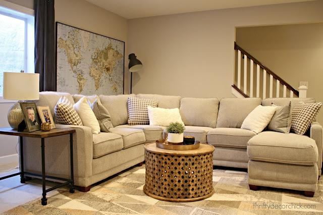 light gray sectional in basement