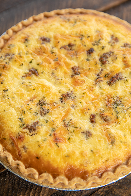 Hissy Fit Quiche - you will definitely throw a hissy fit if you miss out on this quiche! Inspired by our favorite tailgate dip! Sausage, muenster cheese, Velveeta, sour cream, onion, garlic, Worcestershire, eggs, heavy cream. Can make ahead and freeze unbaked for later. SO good! I always have to double the recipe. Never any leftovers! #quiche #brunch #breakfast #freezermeals