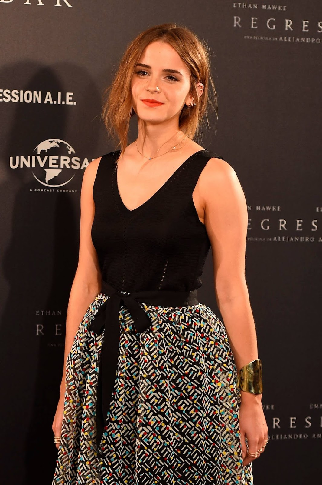 Emma Watson walks the red carpet in multicoloured skirt in Madrid, Spain