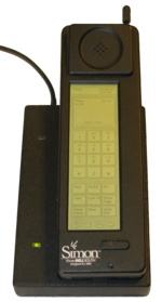 IBM Simon and charging base (1993).