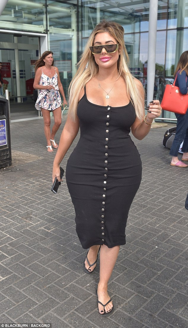 Chloe Ferry flaunts her surgically-enhanced hourglass figure in tight dress