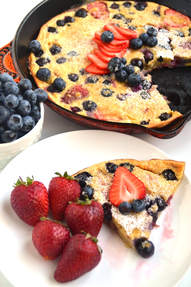 Strawberry Blueberry Dutch Baby makes the perfect breakfast or brunch dish! Made healthier with whole-wheat flour and loaded with fresh berries and ready in less than a half-hour. www.nutritionistreviews.com