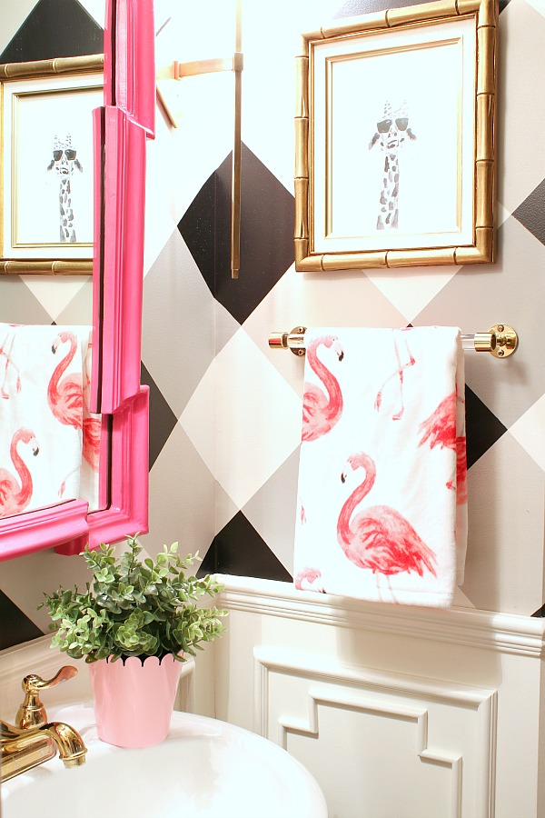 black and white gingham walls, buffalo check walls, flamingo hand towel, bamboo frame, giraffe print, craigslist finds