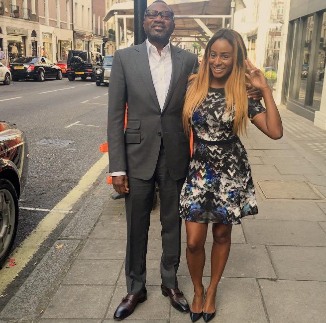 "DJ Cuppy poses with her ""oga at the top"""